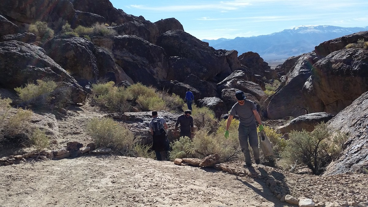 Hikers exploring the grounds and boulders of Volcanic Tablelands