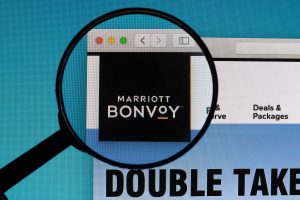 Marriott Bonvoy logo under magnifying glass
