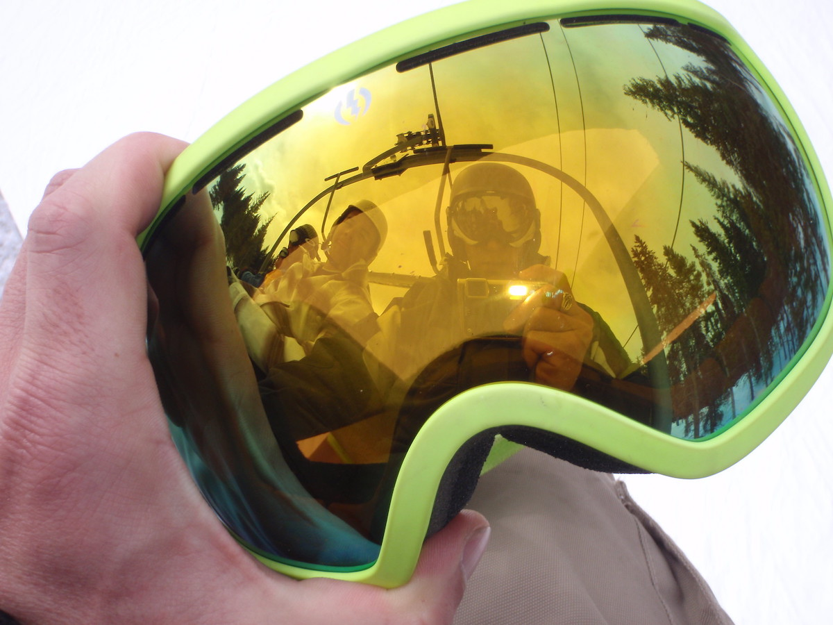 Man playing with reflection on his ski goggles