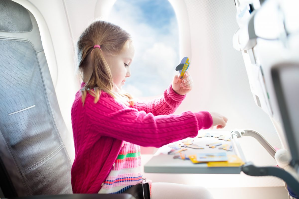 Flying with kids in a plane.