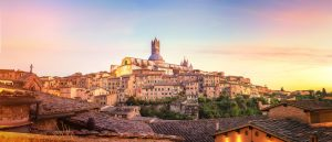 Colorful sunset city view in Siena, Tuscany - Italy