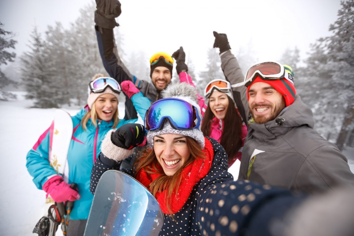 Skiers taking group photo