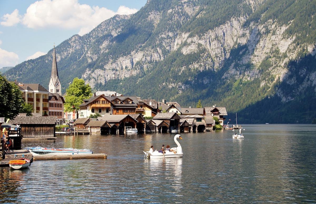Tourists enjoying a boat ride along the stunning Lake Hallstatt Austria