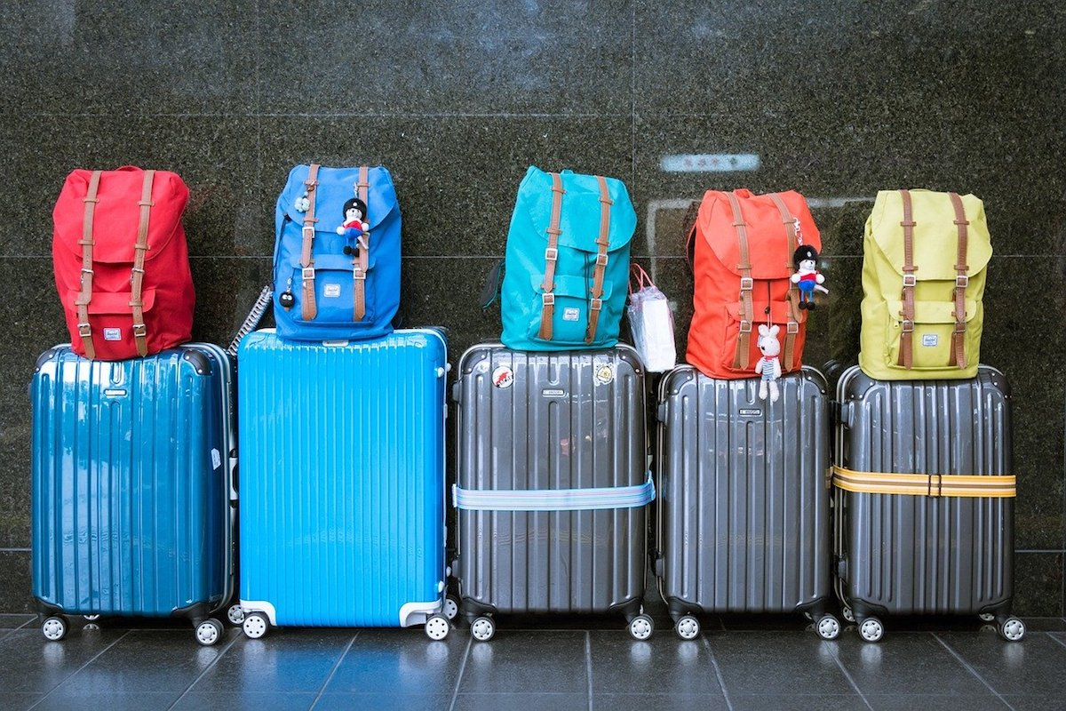 Colorful luggages and carry-on bags lined up