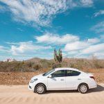 White sedan parked in a desert