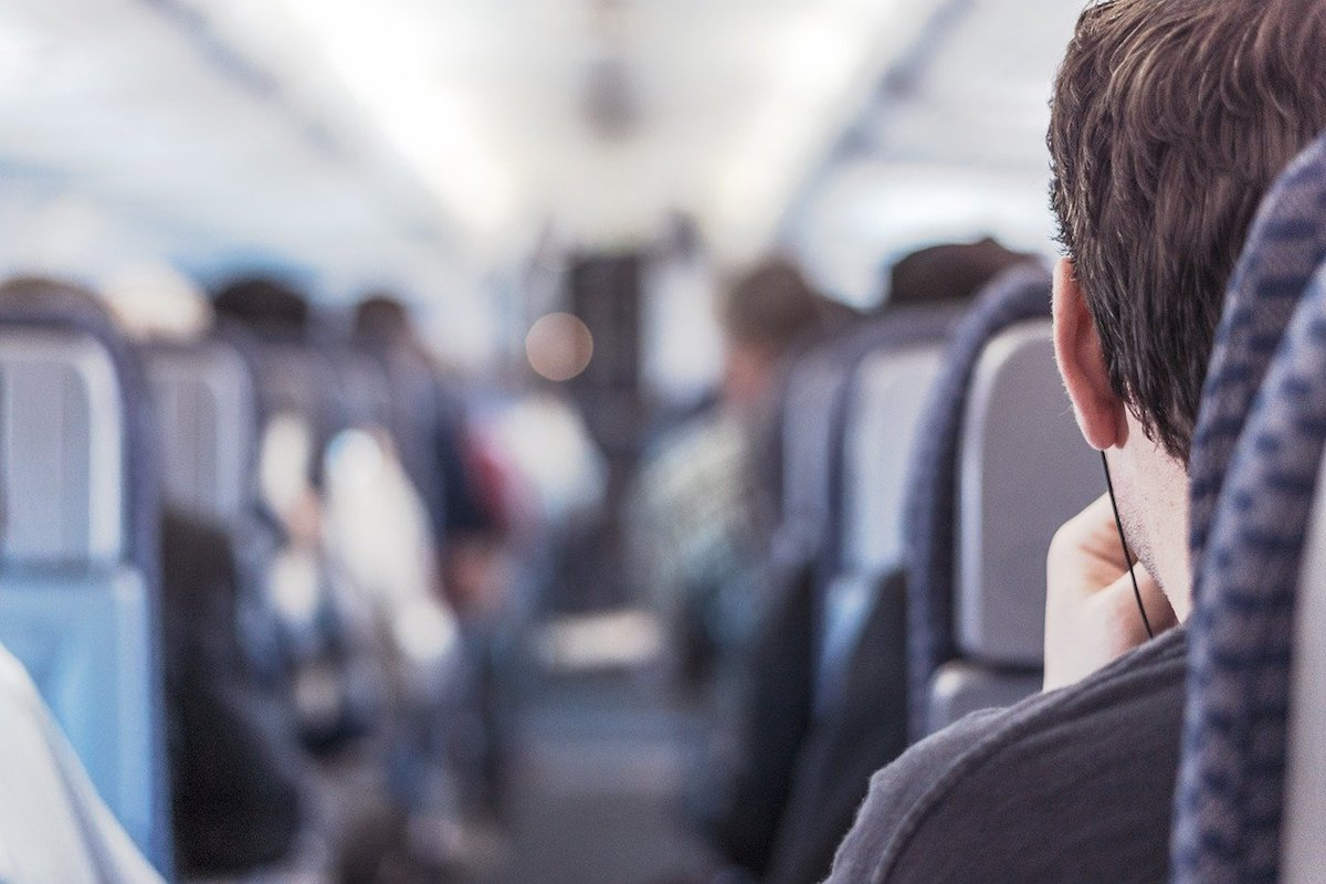 Airplane passenger sitting on aisle seat