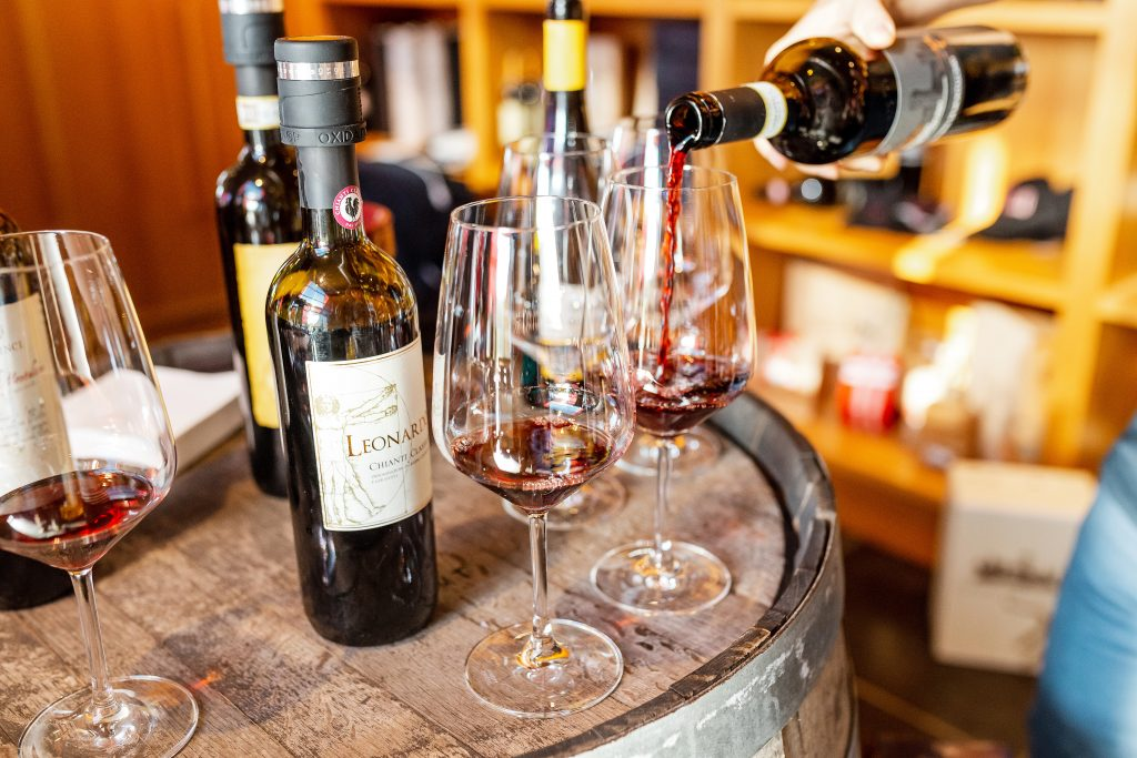 Pouring red wine into wine glass, Tuscan wine