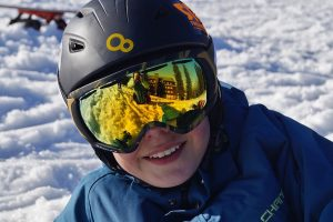 Front shot of ski goggles over helmet