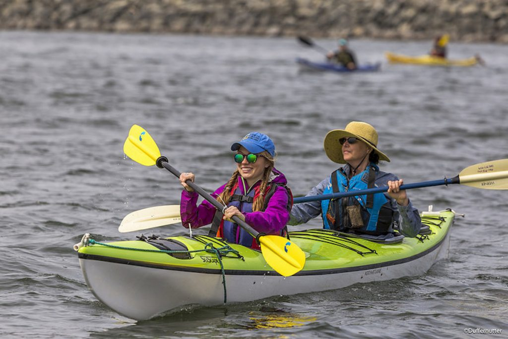A couple of happy kayak paddlers out for a tandem kayak experience