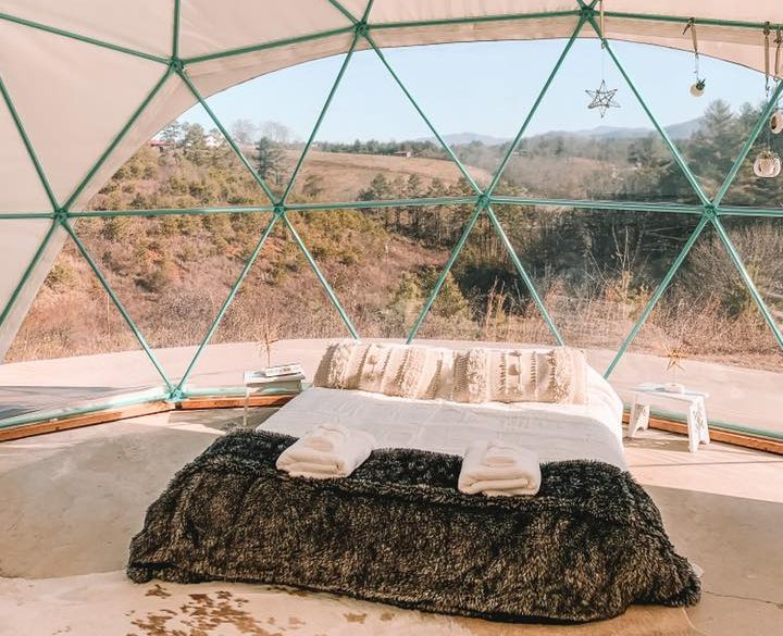 Mattress set under the clear glamping dome