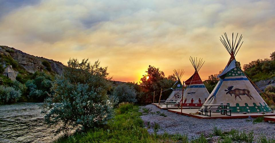 Teepees pictured against the sunrise
