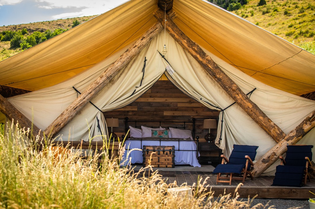 Stripped down conestoga-themed glamping tent