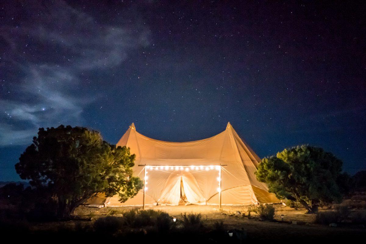 Luxury tent lit up in golden lights