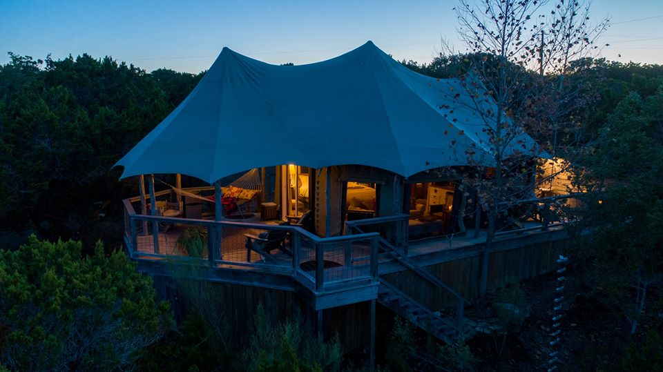 Sinya's famous glamping lodge lit up at night
