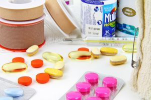 Medicine pills and emergency equipment on a table