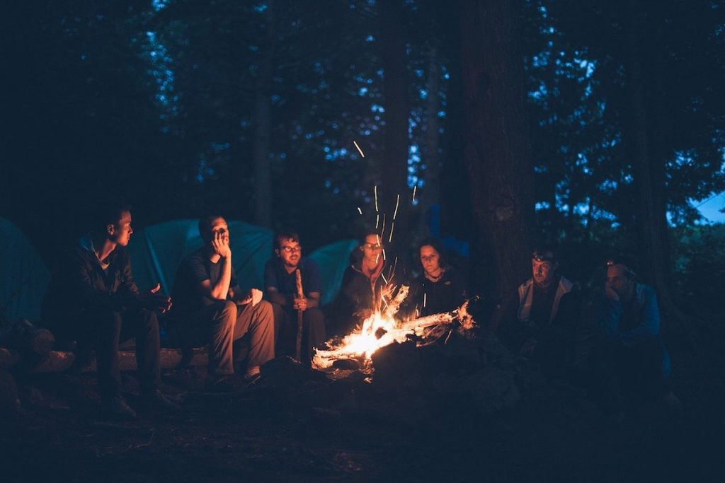 Group of campers around a bonfire