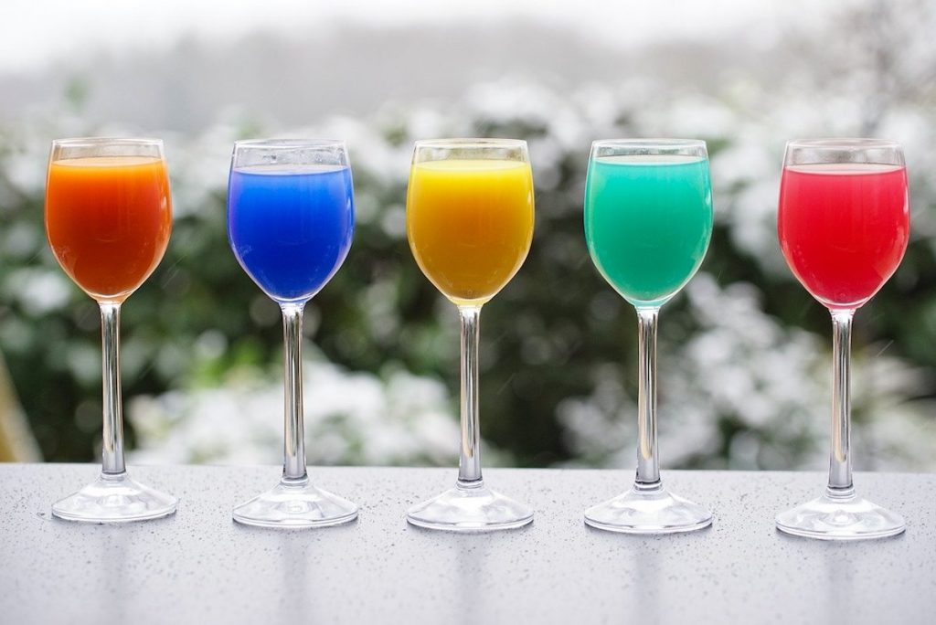 Colorful cocktail drinks in a row