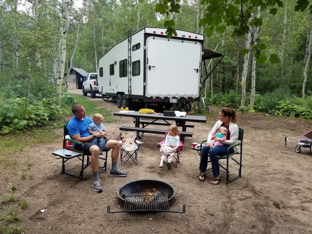 Happy family during summer camping