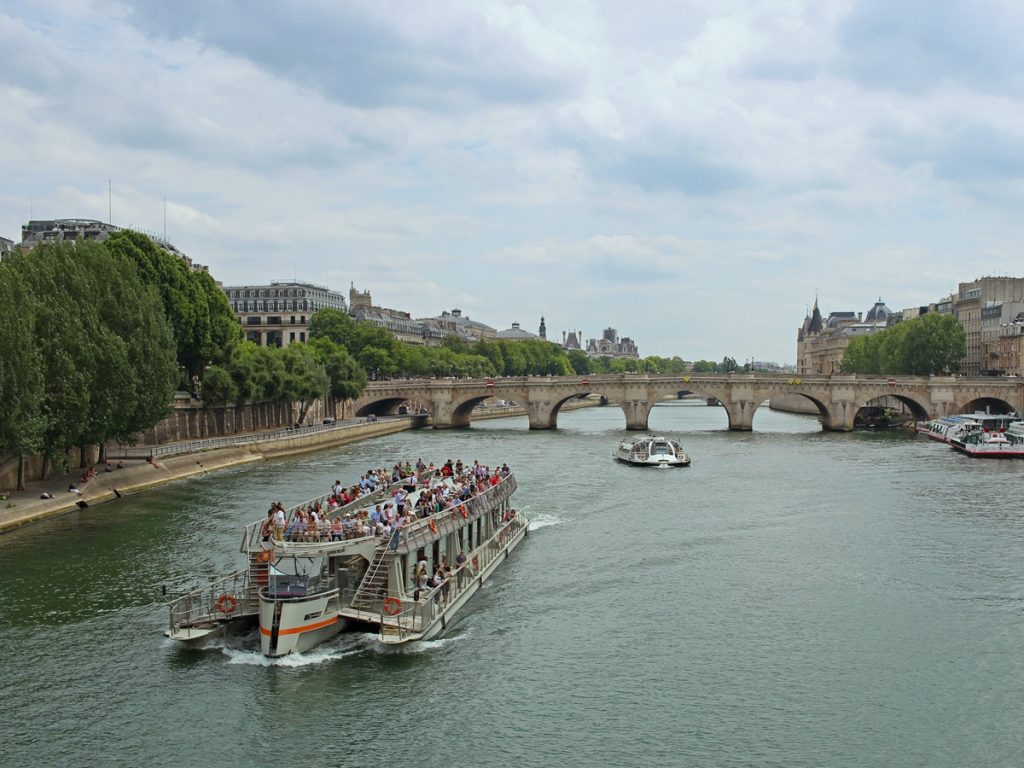 Open top boat cruising on the Seine River