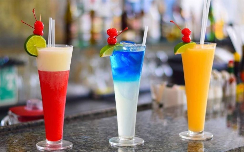 Three refreshing cocktail drinks in a Mexico bar