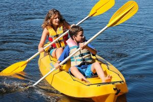 Mother and son on a yellow tandem kayak