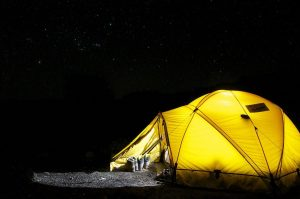 A single dome tent on a starry night camping