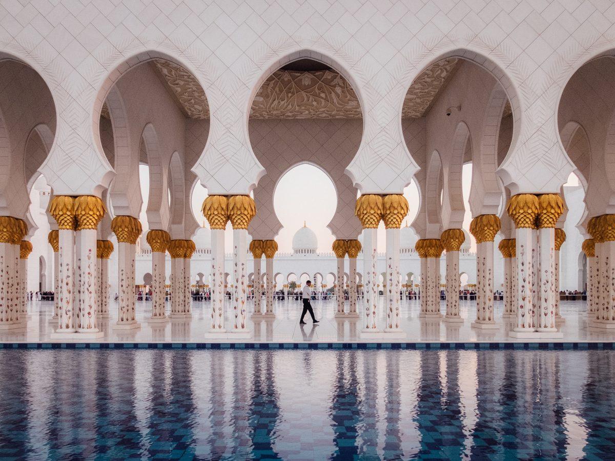 White golden mosque reflection on pool Abu Dhabi